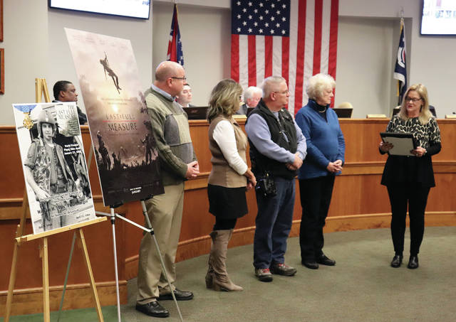 Former Mayor Kazy Hinds, far right, reads a Proclamation at Tuesday's commission meeting, declaring the week of January 20-26, 2020 to be William H. Pitsenbarger Week in Piqua. On Thursday, January 23, the premier of the film The Last Full Measure will be held in Piqua beginning with a reception at the Miami Valley Cenre Mall at 5:30 p.m. following by several screenings of the film at Cinemark Cinemas. Further details will be released soon. With Hinds are LFM Committee members Dwayne Thompson, Kathy Sherman, Mike Ullery, and Ruth Koon.