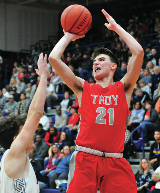 Troy's Landyn Henry shoots a jumper Friday night against Piqua at Garbry Gymnasium.