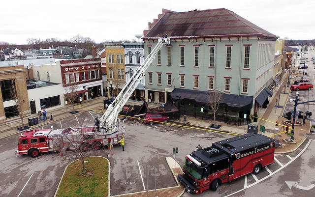 Troy Fire Department utilized Tower 1 again on Sunday to assess damage to building in the downtown area.