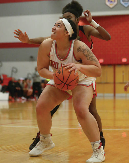 Lee Woolery | Miami Valley Today Troy's Tia Bass sizes up a shot in the paint during Wednesday's win over West Carrollton at the Trojan Activities Center.