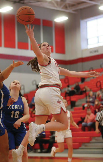 Lee Woolery | Miami Valley Today Troy's Macie Taylor lays the ball up on a drive during Saturday's win over Xenia at the Trojan Activities Center.
