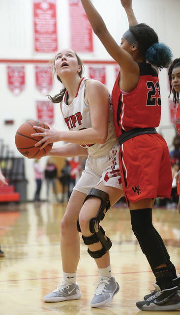 Lee Woolery | Miami Valley Today Tippecanoe's Hannah Wildermuth works in the paint against West Carrollton's Taryn Dewberry Wednesday at Tippecanoe High School.
