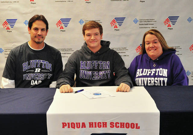 Mike Ullery|Miami Valley Today Piqua High School senior Jarret Powers signed his letter of intent to play soccer for Bluffton University recently. Powers his shown with his father Kelly and mother Jamie.