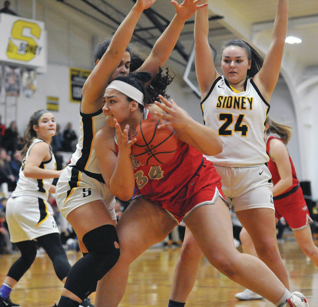 Josh Brown | Miami Valley Today Troy's Tia Bass powers her way to the basket through a Sidney double-team Wednesday at Sidney High School.