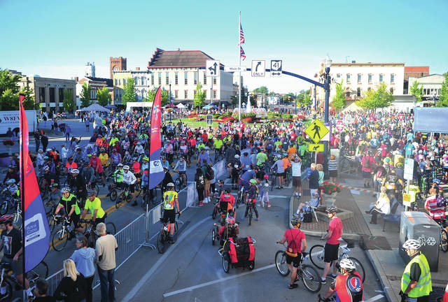 3,000 cylists and thousands of spectators fill the public square in downtown Troy for the 2019 Tour de Donut event.