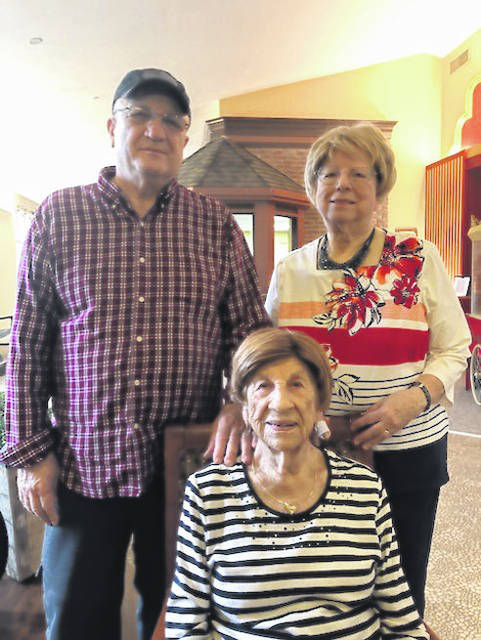 Former Piqua resident Lucille Sansam celebrated her 104th birthday on Tuesday. She's pictured with her son Rick Supinger and daughter Shirley Norris at the Randall Residence assisted living center in Tipp City.