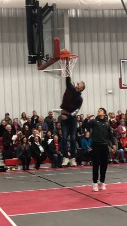 """On Sunday, Newton High School freshman Harold Oburn, with help from senior Kleyton Wehrley, """"christened"""" the new Newton Fieldhouse and Community Center with a slam dunk on the basketball court."""