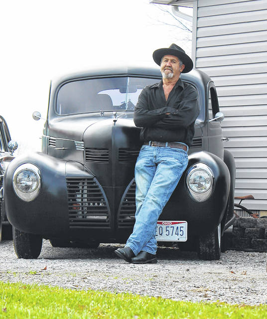 Blaich Zeller, of Troy, has five vintage cars, along with a house and garage full of antiques, all of which he has collected over the past 20 years.