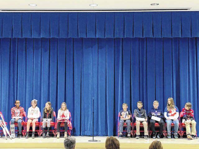 From left to right, Daria Lee, Olivia Hudgel, Addison Leonard, Olivia DeBrosse, Eric Grimm, Landon Sullenberger, Kaden Earick, Grace Harshbarger, and Noah Bishop wait on stage for the city-wide spelling bee to begin on Thursday at Piqua Central Intermediate School.