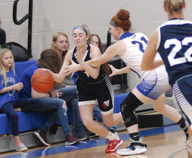 Rob Kiser|Miami Valley Today Piqua's Adde Honeycutt is pressured by Fairlawn's Alexis Graves Monday night.