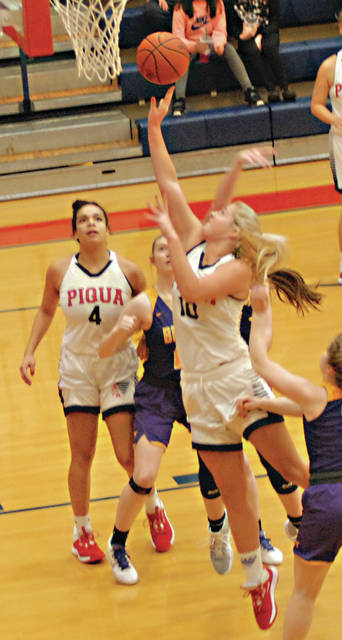 Piqua's Aubree Schrubb gets a shot off against Butler as teammate Tylay Yeomans looks on.