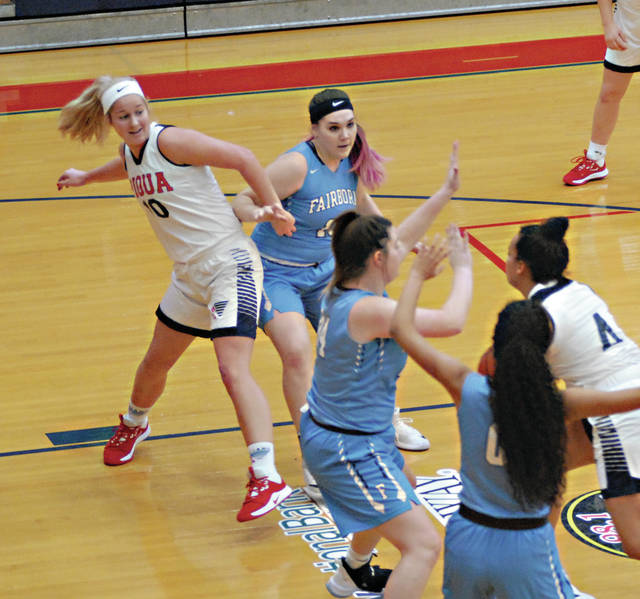 Rob Kiser Miami Valley Today Piqua's Aubree Schrubb is hooked by Fairborn's Cassidy Mustard as Tylah Yeomans attempts to pass the ball to Schrubb.
