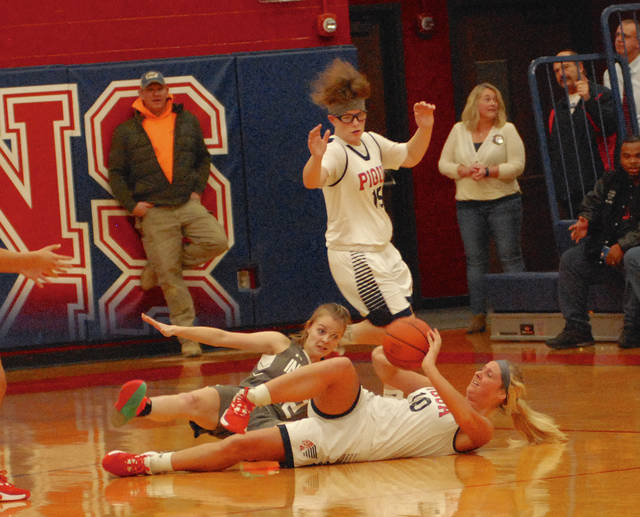 Rob Kiser|Miami Valley Today Piqua's Aubree Schrubb tries to pass the ball from the floor against Stebbins Thursday night as Karley Johns (15) looks on.