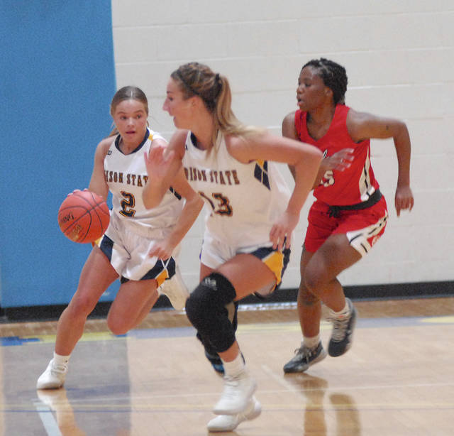 Rob Kiser|Miami Valley Today Edison State's Audra Schaub races up the floor against Sinclair's Naomi Hookfin as Edison State's Maddy Bakosh leads the way.