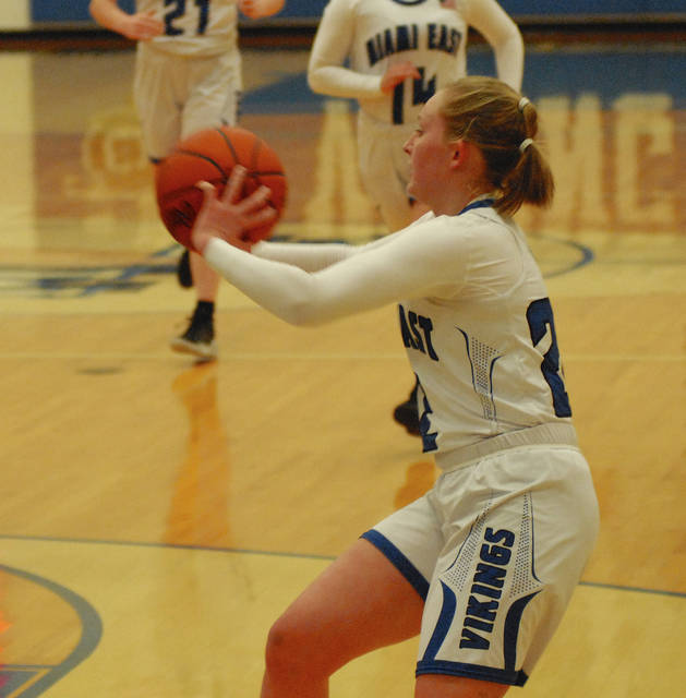 Rob Kiser Miami Valley Today Miami East's Cadence Gross passes the ball against Newton Thursday night.