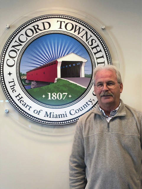 Neil Rhoades retires as Concord Township's road superintendent after 46 years of service, transitioning into the role of trustee.