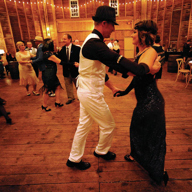 John and Katie Voisinet of Piqua, and their guests, dance the Jitterbug during a Roaring '20s Dance at the Orrmont Round Barn. DWPS dance instructors The dance was the first fundraiser of the season for the 2020 Dancing With the Piqua Stars which will be held on April 18.