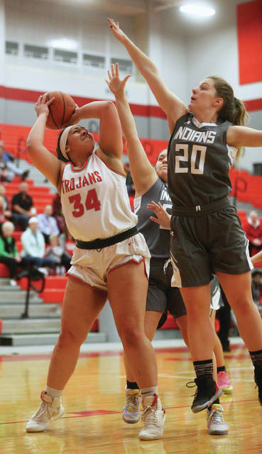 Lee Woolery   Miami Valley Today Troy's Tia Bass scores in the paint Wednesday against Stebbins at the Trojan Activities Center.
