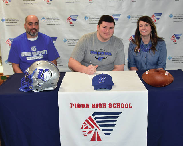 Mike Ullery|Miami Valley Today Piqua High School senior Riley Hill signed his letter of intent to play for Urbana University. Hill is shown with his parents Joe and Misty Hill.