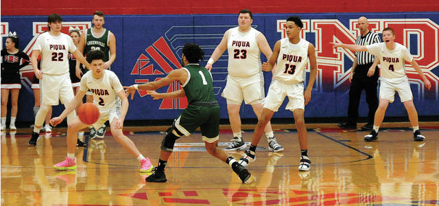 Piqua plays a zone defense against Greenville. On the floor for the Indians are Iverson Ventura (22) Owen Curtis (2), Riley Hill (23) Dresean Roberts (13) and Cameron Foster (4).