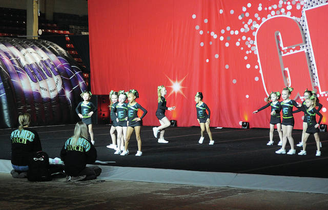 A cheer group form the Cheerbarn in Houston competes in Saturday's Greater Midwest Cheer Expo at Hobart Arena in Troy.