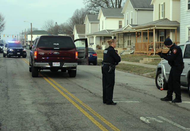 Piqua police investigate a Wednesday morning crash involving a child pedestrian and a pickup truck in the 800 block of South Street.