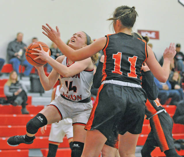 Josh Brown | Miami Valley Today Milton-Union's Morgan Grudich drives to the basket against West Liberty-Salem during the first round of the Division III sectional tournament at Northridge High School.