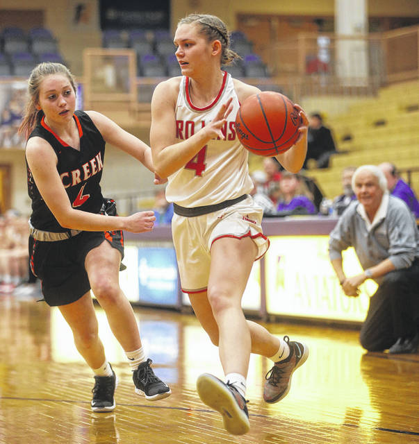 Lee Woolery | Miami Valley Today Troy's Laura Borchers drives to the basket past Beavercreek's Ashley Vaughn during a Division I sectional tournament game Tuesday at Butler High School.