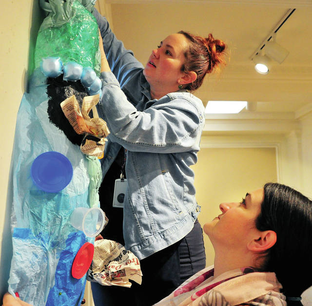 """Troy Junior High School art teachers Laura Cantrell and Gabbie Braun begin the process of hanging the 2020 Troy Area Schools <em>Young Masters</em> Art Show at the Troy Hayner Cultural Center on Tuesday afternoon. The exhibit, which opens on Friday, will feature art from K-12 students at Troy City Schools, Troy Christian Schools, St. Patrick, Miami Montessori, and Overfield. The show will be open from February 21 to March 29. """"The idea is to display the best of the best of the works in each of our buildings,"""" said Jill Hartman, art teacher at Troy High School. There will be a family, invitation-only, reception on Monday February 24, from 6-7:30 p.m."""