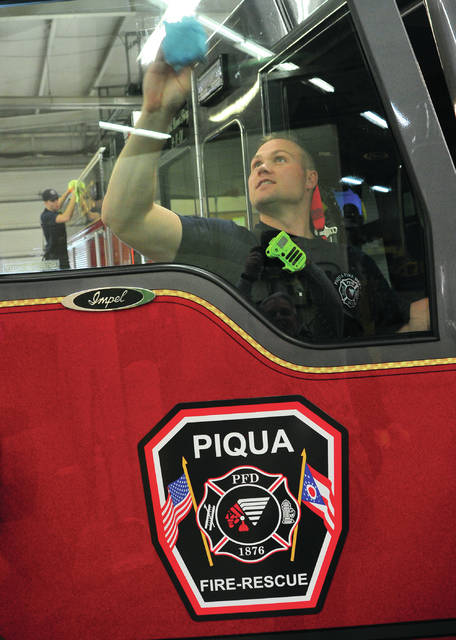 Piqua Firefighter Corbin Peltier washes a window on the department's new addition to the fleet, a Rescue/Engine 3. The vehicle was delivered on Wednesday morning. Following a wash and inspection, it will be delivered to an area company for final outfitting and radio installation. The truck is expected to enter service sometime in April.