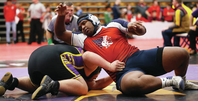 Lee Woolery | Miami Valley Today Piqua's Lance Reaves-Hicks scores a reversal against Butler's Zach Back at the MVL Tournament Friday at Butler High School.