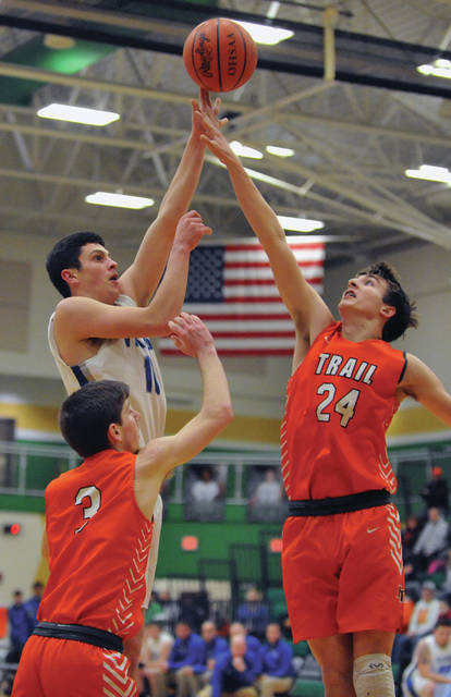 Josh Brown | Miami Valley Today Miami East's Sam Zapadka shoots over National Trail's Tyler Weathington during a Division III sectional tournament game Thursday at Northmont High School.
