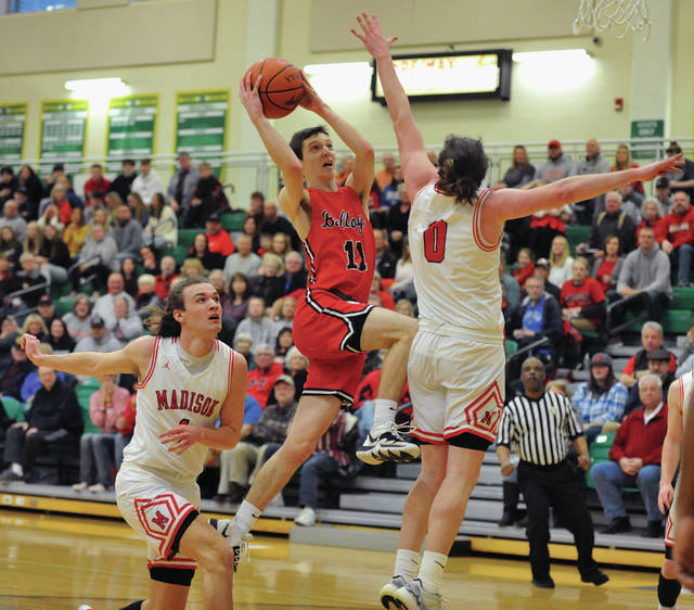 Josh Brown | Miami Valley Today Milton-Union's Sam Case drives to the basket during a Division III district semifinal game against Madison Saturday at Northmont High School.