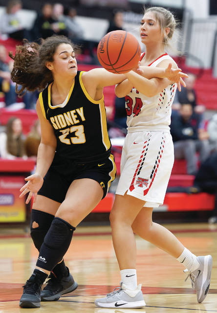 Bryant Billing | AIM Media photo Tippecanoe senior Katie Salyer passes around Sidney's Allie Stockton Wednesday at Tippecanoe High School.