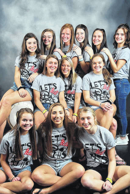 The Covington Varsity Cheerleading squad, from left to right, front row, Erika Gostomksy, Alyssa Kimmel, and Lauren York; middle row, Ella Warner, Courtney Smidutz, and Tori Quinter; back row, Libby Shaffer, Maddy Jones, Kayla Mitchell, Alexis Meyer, Hailie Jo Taxis and Hailey Weer.