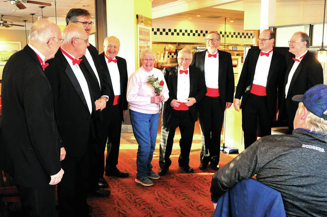 "A pair of ""Barbershop Quartets"" form the Melody Men Chorus serenades Shirley DeWeese at the Piqua Bob Evans restaurant on Friday morning. The Melody Men have been providing Valentine's Day songs around the area for 23 years."