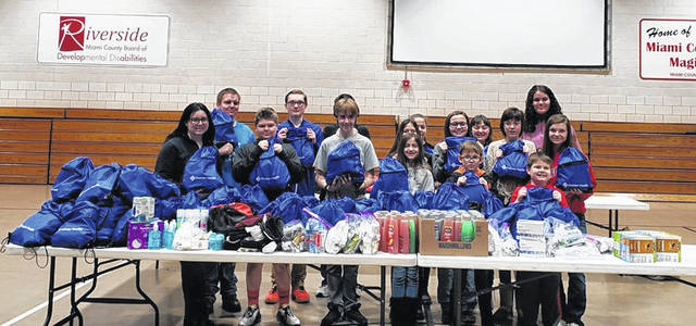"Provided photo Miami County 4-H club members and families donated various hygiene and personal items to fill more than 100 ""cold care"" bags, which will be distributed to the Franklin House women's shelter."