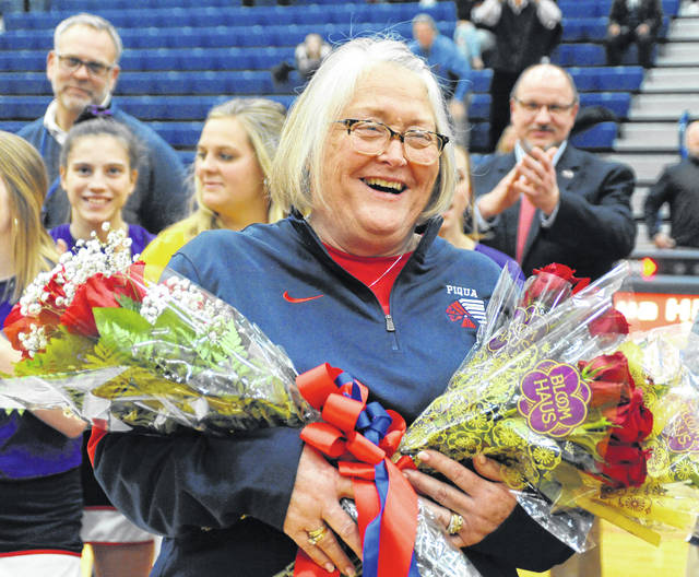 Jojo Marrs, administrative assistant for the Piqua High School athletic department, recently retired after nearly 30 years of service within the district. Marrs worked for all four PHS principals and athletic directors. She was honored during halftime of the Jan. 31 PHS boys basketball game.