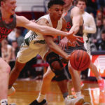 Troy Christian boys battle to end in loss to top seed Jackson Center