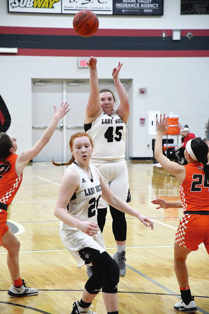 Ben Robinson|GoBuccs.com Covington's Josie Crowell shoots a 3-pointer as teammate Claudia Harrington gets in position for a rebound Thursday night against National Trail.