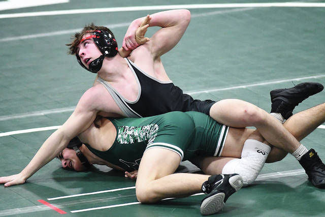 Ben Robinson|GoBuccs.com Covington's Kellan Anderson sets up a turn for back points against Greenville's Ben Hartzell in a 132-pound match.