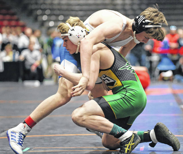 Lee Woolery | Miami Valley Today Troy Christian's Ethan Turner made quick work of both of his opponents on the first day of the Division III district tournament Friday at Hobart Arena.
