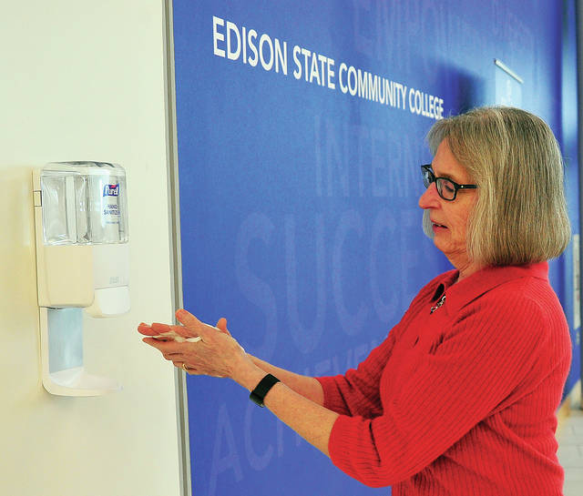 Darlene Francis, Coordinator of Health and Wellness Services for Edison State Community College, visits a hand sanitizing station at the school on Wednesday morning. Although Edison is on spring break, staff members and students who are still on campus are taking extra precautions to avoid potential illness during the current Coronavirus situation.