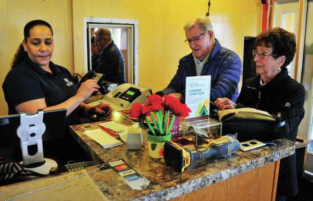 Al Swafford of Troy and Mary Rice of Vandalia place a carry-out order with Caina Lee, at Lincoln Square Family Restaurant in Troy on Monday. While the dining room is closed due to the current health crisis, Lincoln Square is open regular hours for carry-out and has added the option of delivery for orders within a 10-mile radius.