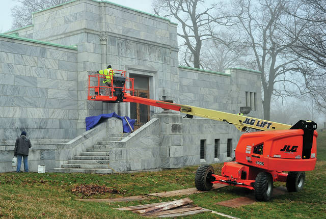A break in the weather allowed work crews from Midwest Maintenance in Piqua to work on tuck-pointing masonry at the Forest Hill Cemetery Mausoleum on Wednesday morning.