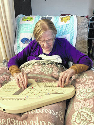 Provided photo Lenetia Shoemaker, a patient of Ohio's Hospice of Miami County, plays the omnichord.