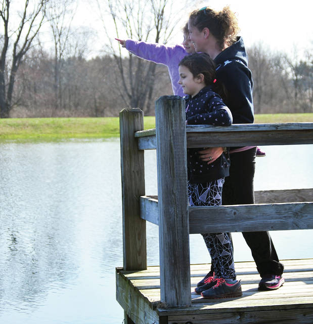 Julie Dewey of Troy took advantage of Thursday's spring weather to explore the trails at the Miami County Park District Garbry Big Woods, along with her kids Harper, 6, and Piper, 3.