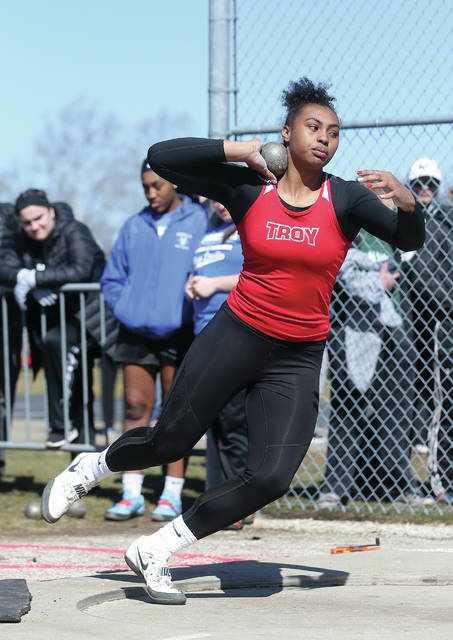 Lee Woolery | Miami Valley Today file Troy's Lenea Browder throws the shot put in last year's Troy Up and Running Invitational. This year's Up and Running Invitational was scheduled to take place on Saturday and was among the first events lost due to the spring season's postponement.