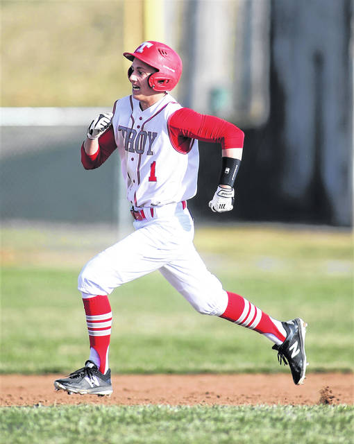 Lee Woolery   Miami Valley Today file Troy's Weston Smith runs the bases during a game last season.