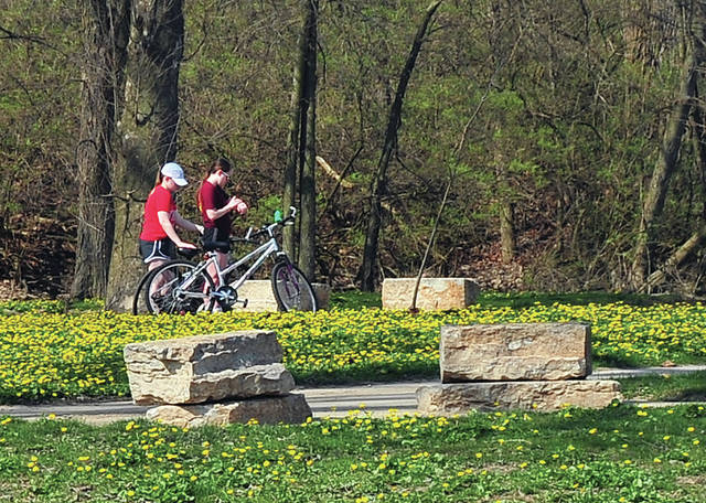Spring colors are beginning to arrive as people are getting out to enjoy Treasure Island Park in Troy over the weekend.